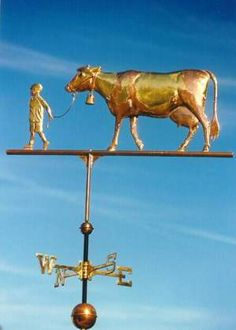 Dairy Cow with Boy Weathervane by West Coast Weather Vanes.  This handcrafted Holstein cow with boy weathervane was custom made using their son Carl. He was the model with the bowl haircut and blue eyes!