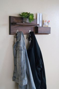 Keep your entryway stylishly organized with this Midnight Woodworks original design. Our handcrafted shelf and hook entryway organizer is an