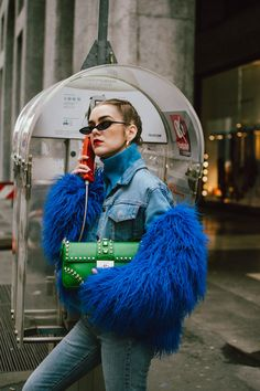 Blue faux fur jacket, levi's cropped light wash jeans, blue cashmere turtleneck sweater, gucci white and red leather sneakers, green saffiano leather prada shoulder bag with studs and stones, small cat eye sunglasses, andreea birsan, couturezilla, cute spring outfit ideas 2018, micro sunglasses trend, retro sunglasses, blue and green outfit, how to pull off double denim, how to wear double denim, denim cropped jacket, denim on denim spring outfit, gold hoop earrings, matrix sunglasses, how…