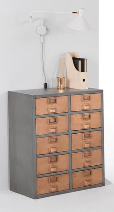 The Stow large storage unit is now available in copper. Stow is an apothecary-style sideboard updated with a modern-industrial attitude. It maintains its lovely vintage feel with aged copper. £399 MADE.COM