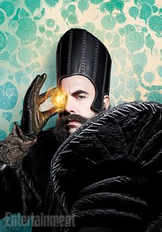Sacha Baron Cohen is Time personified in Disney's Alice Through the Looking Glass. Super blue eyes and some very unique leather and velvet jacket. Will make for interesting cosplay  attire.