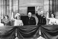 The British Royal family and Prime Minister Winston Churchill responding to the cheering crowds on the surrender of Germany, Buckingham Palace balcony, London, England, United Kingdom, May 8, 1945.  (United Kingdom National Archives)
