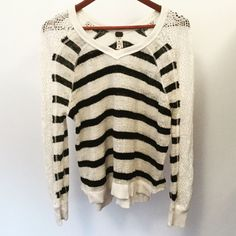 FREE PEOPLE Lace Sleeve Sweater Adorable Black/Ivory Free People Sweater with Lace Sleeves!! Loose fitting, the tag says XS but it's loose fitting for even a size small. Has only been worn 2xs, in Very good condition! Free People Sweaters Crew & Scoop Necks