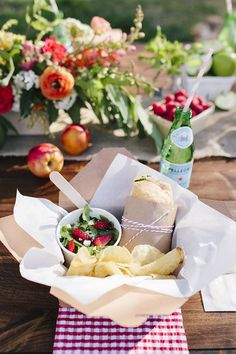 """A """"Picnic in the Park"""" themed baby shower is a simpler way to pull off a baby shower with a Baby-Q feel. Personalized meal boxes are such a great idea! 