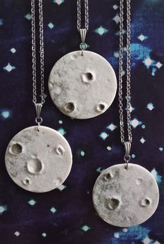 Realistic Moon inspired pendants, textured with layers of colour and glazing combined with little craters.