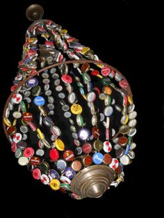This chandelier made ​​entirely of recycled parts takes up the idea of Victorian chandeliers . ++ More information at La Fabrique à broc website ! Idea sent by SAILLOUR Anne So ! Bottle Cap Projects, Bottle Cap Crafts, Bottle Cap Art, Bottle Top, Recycled Crafts, Diy And Crafts, Arts And Crafts, Recycling Information, Beer Caps