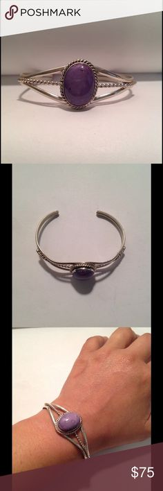"""Vintage Sterling NA Charoite Cuff Vintage Sterling Native American Charoite cuff bracelet. Beautiful purple stone with twisted rope design. Stone measures 7/8"""" long X 5/8"""" wide. Cuff is adjustable. Marked Sterling on the inside of cuff. Vintage Jewelry Bracelets"""