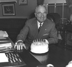 President Harry S. Truman receiving a cake for his 67th birthday in the White House, May 8, 1951.