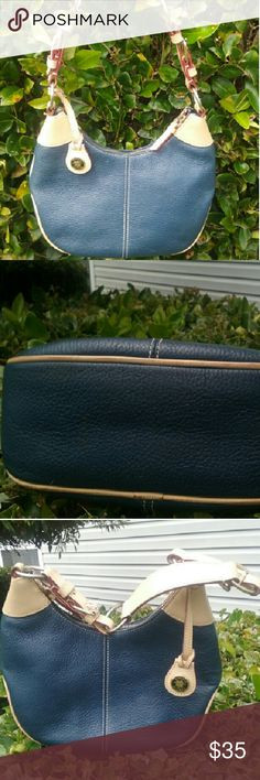 """Dooney Bourke  #H3368628 pebbled leather bag purse Dooney Bourke #H3368628 navy blue pebbled leather Shoulder bag. Light tan leather trim. Interior has 1 zip pocket , 1 slip pocket . 'DB' charm attached.  Has scuffs and marks in/out. So Cute!! L 11' H middle 6.5:, ends 8"""" Strap drop 11"""" Dooney & Bourke Bags Shoulder Bags"""