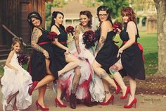 like the red shoes and bow with black dress, These would be cheap for the bridesmaids to find/do :) Just add red sash to existing black dresses.