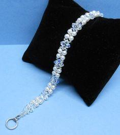 Perle und Kristall Armband Swarovski Gemacht mit Swarovski-Perlen,Kristall und japanischen Rocailles.  Perlen sind weiß.