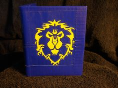 World of Warcraft Alliance Symbol Duck Tape Wallet. now if it wasnt duck tape and black, this would be sweet.