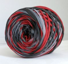 This t shirt yarn was made from a 100% cotton jersey t shirt. It was washed in dye free fragrance free detergent. After it was dry, I cut it to a width of a 1/2. This is one continuous strand, there are no knots or seams. This yarn has been dyed Black/Gray/Red, it will match the following solid colored yarns I carry: Slate, True Red, Gray  THE DETAILS: 50 yards 5-6 wpi About 4 oz in weight  Best Tools for the Job: Crochet Hook: J, I, K Knitting Needle: US8, US 9, US10  Good for rug making…