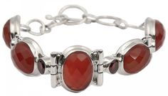 Fiery ovals of carnelian alternates dazzling garnet cabochons set in gleaming silver to cast aromatic glow in this link bracelet. The gems are set in sterling silver and create a feminine design which radiates passion.