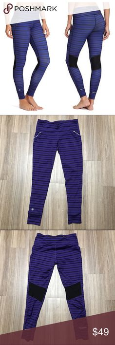 """Athlete Relay Striped Tight Amalfi Blue Athleta leggings in a purple/blue and black stripe. Semi ruched with mesh panels. Performance fitted leggings for running and training or everyday wear. Mid-rise. Neverend drawstring, rear zip pocket. Reflective trim. Like new condition. Inseam 26"""". Athleta Pants Leggings"""