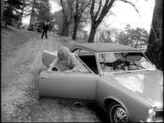 """Judith O'Dea escapes from her 1967 Pontiac Tempest in """"Night of the living Dead"""" (1968)."""
