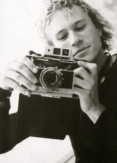 Pic of Heath Ledger with camera ... he seems so down to earth here...