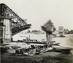 Eads Bridge construction. Erection of west and center arches, view looking northeast, September 1873. On Feb. 5, 1864, the STL and IL Bridge Company was incorporated with 1 million dollars to build a bridge across the Mississippi. James B. Eads was selected to build a bridge with 3 spans of more than 500 ft., twice as long as any yet built. Missouri History Museum
