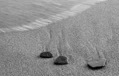 Rocks on the beach.  Postcards, greeting cards, photographic prints available.