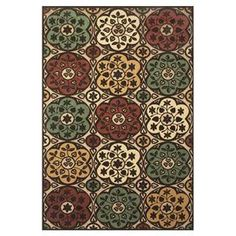 Indoor/outdoor rug in tan and brown with a floral motif.  Product: RugConstruction Material: PolypropyleneColor: Tan and brownFeatures: Suitable for indoor and outdoor use Note: Please be aware that actual colors may vary from those shown on your screen. Accent rugs may also not show the entire pattern that the corresponding area rugs have.Cleaning and Care: Vacuum on hard floor setting