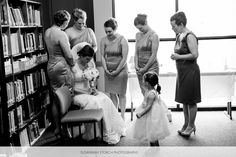 Stunning Picture of the Bridesmaids Praying With and For the Bride.