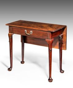 A George II period mahogany night table; the well figured top with drop-leaf flap to the rear above a frieze drawer which retains its original rococo swan neck handle and raised on club legs which are lappett carved to the knee and terminate in pad feet. Retaining an excellent colour and patination, 1750 #hall #table #nighttable