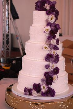 Lisianthus trailing down the cake. Two-tone and deep shades of purple  Josephs Events