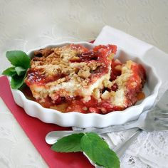 Cherry Dump Cake Cobbler - this recipe works with almost any combination of pie fillings or canned fruit and any kind of nuts. This recipe has cherry pie filling and pineapple chunks. Takes only about 5 minutes to prepare yet tastes delicious. Serve warm with ice cream.