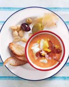 Don't overlook the importance of the accompaniments. Eggs, tuna, cured meats, and other protein-rich items make the otherwise light-bodied soup a satisfying meal. Set everything out in separate dishes, and let everyone pick and choose among the offerings.