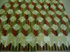 Tumbling Logs, a Log Cabin quilt by Alexandra408, via Flickr. Pattern is in Judy Martin's Log Cabin Quilt Book.