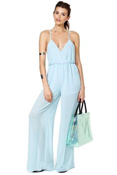 We were lusting for a jumpsuit that kept those sexy legs front and center-- so we made one!  It has spaghetti straps, cinched waist, v-neckline, and sheer pant legs for an extra dose of unstoppable.