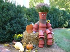 Love the flower pot people created by the Roswell Garden Club for Fall Farm Days at Smith Plantation.