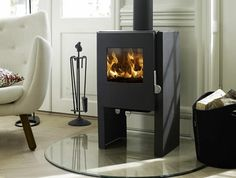 1446 Convector Plain Sides - The Morso 1446 is a distinctive convection stove that demonstrates the new design of the 1400 series. Convection principles are efficiently met whilst maintaining the contemporary appearance of a modern stove. Convection Stove, Morso Stoves, Modern Stoves, Log Burner, Kitchen Units, Wooden Flooring, Wood Burning, Furniture Decor, Modern Design