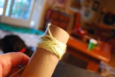 Use a toilet paper tube to wind your yarn into neat little balls.