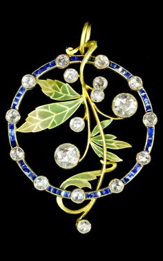 Masriera Brothers - An Art Nouveau gold, plique-à-jour enamel, diamond and sapphire pendant. Set to the centre with a scrolling branch with enamelled leaves and rose cut diamonds, within a border of rose cut diamonds and baguette cut sapphires, 48mm diameter. #Masriera #ArtNouveau