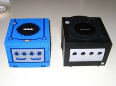 Doctor Octoroc's 3D Gamecube bead sprite console next to an actual Gamecube