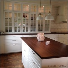 white bodbyn cabinets. i'm really liking the dark counters here...