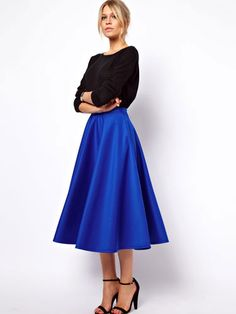 .Full skirts for 2014, black sweater and tied together with angle strapped black heals. Retro? or Classic?