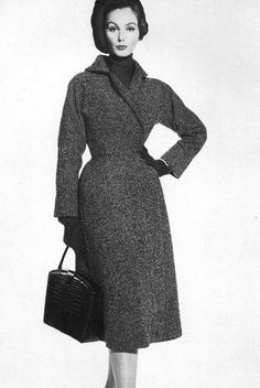 1957 fitted tweed coat that wraps and closes on the side by Pauline Trigere