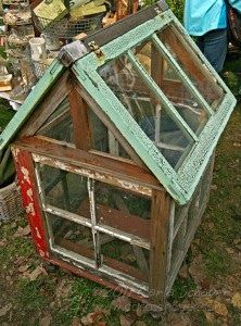 Old windows upcycled into mini greenhouse. Great way to repurpose for outdoor decor.