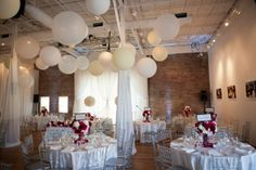 Modern Pink Red Silver White Centerpieces Chairs Indoor Reception Modern Space Spring Tablescape Wedding Reception Photos & Pictures - WeddingWire.com