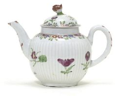 1765 A WORCESTER REEDED GLOBULAR TEAPOT AND DOMED COVER CIRCA 1765 Painted in a vivid Oriental palette with scattered chrysanthemum and Oriental flowers below bands of further flowers and leaves, with bud finial, the simple handle and spout with iron-red chrysanthemum and seeded ornament 5½ in. (14 cm.) high (2) Christies lot330