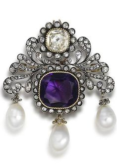 A 19th century pearl and gem-set brooch/pendant. The highly stylised foliate plaque, with a central cushion-shaped amethyst, within a ropetwist border and rose-cut diamond surround, suspending three natural pearl drops, surmounted by a similarly set cushion-shaped topaz in a foiled closed back-setting, highlighted by further rose-cut diamonds throughout, mounted in silver and gold, later brooch fitting.