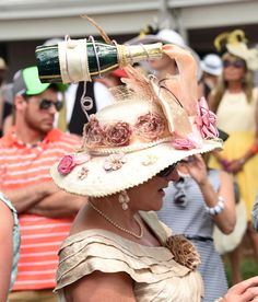 This woman donned one of the most interesting hats of the day that featured a champagne bottle pouring into a cup for the 2015 Kentucky Derby.