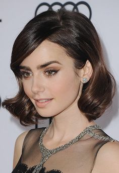 Retro-meets-modern-glam is the name of the game with this look. Update classic winged liner with a subtle bronze sparkle and pair with oh-so-pretty clear lipgloss. Make it super-60s with a slightly backcombed, wavy 'do (think Jackie O vibes) and finish with some subtle ear sparkle