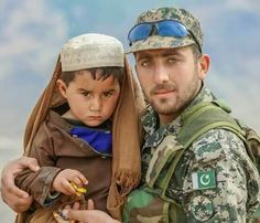 Pakistani solider with an afghan child who crossed border earlier despite terror wave keeping human value. #CUTe