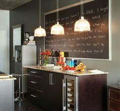Love the large blackboard and cabinet with wine frig!