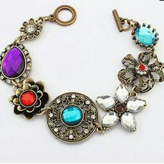 NOW AVAILABLE!! MULTI-COLORED CRYSTAL BRACELET Gold metal with blue, red, white, and purple crystals. Has a matching necklace also in my closet. Boutique  Jewelry Bracelets