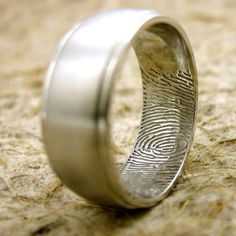 Wedding band for him with brides fingerprint.. this is cool. I really like this..