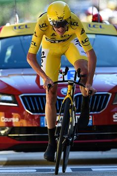 TDF2016 Great Britain s Christopher Froome wearing the overall leader s  yellow jersey crosses the finish line 8936a43a9